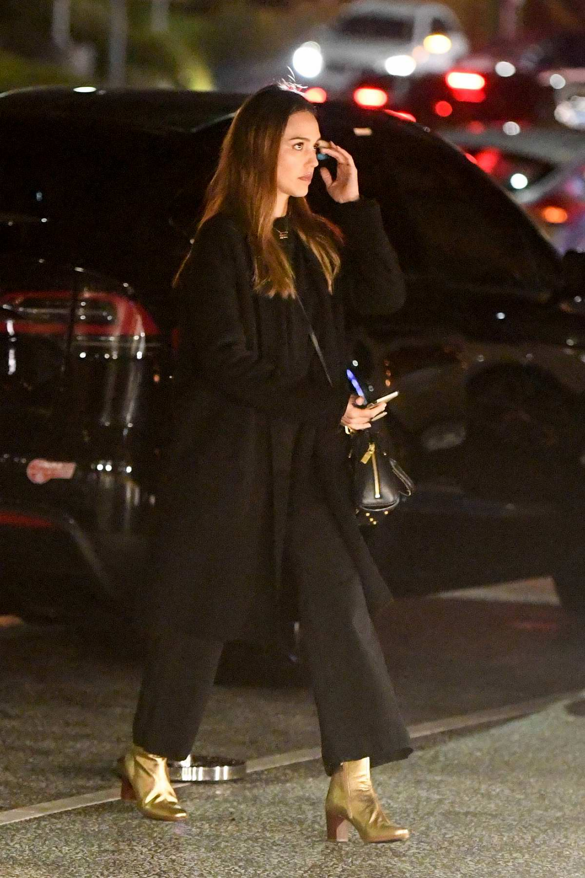 Jessica Alba dons all black ensemble with a pair of golden boots as she takes her daughters to a movie in Los Angeles