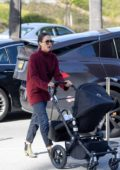 Jessica Alba looks stylish in a maroon turtleneck sweater, jeans and pointed ankle boots while out for lunch with her son in Los Angeles