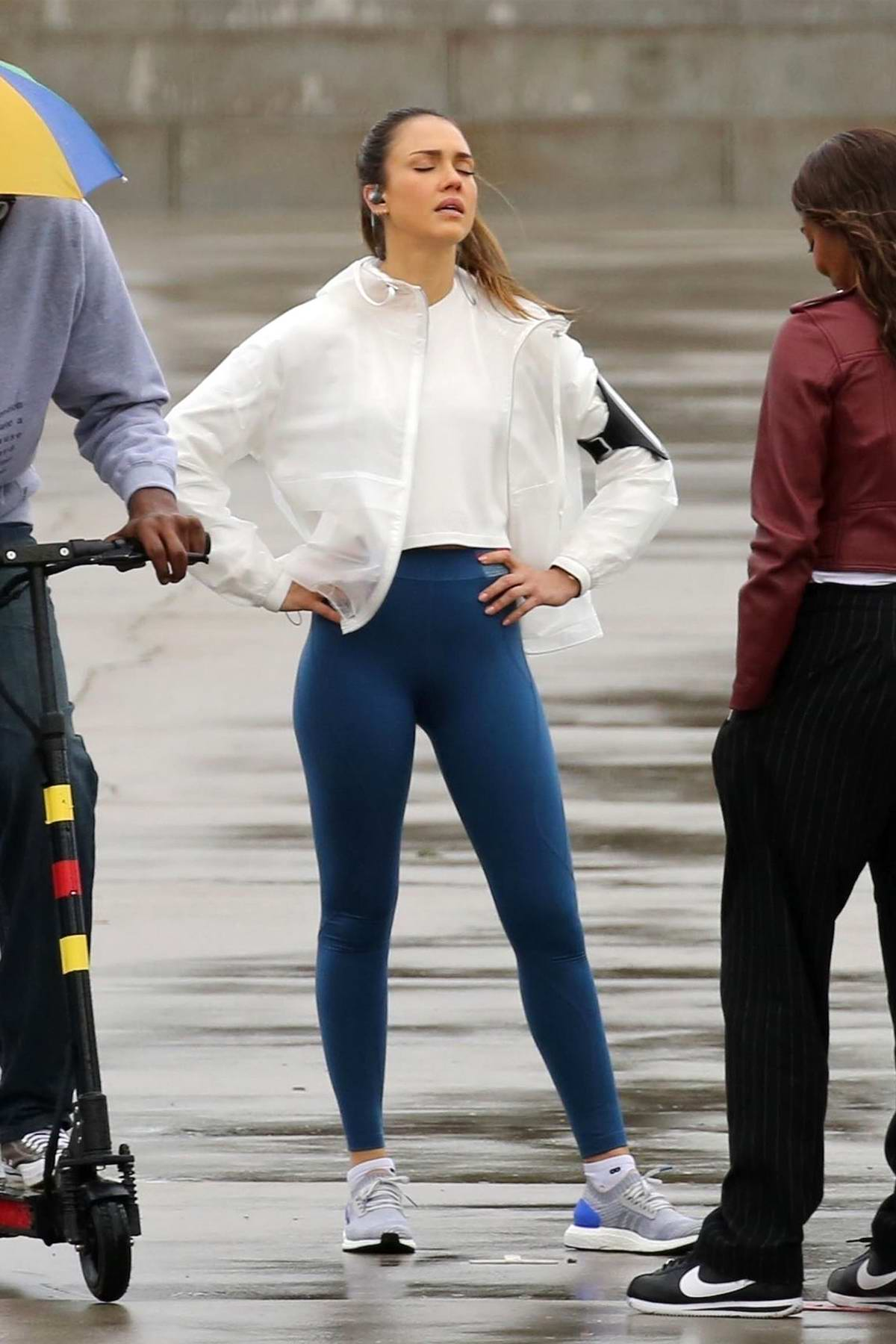 Jessica Alba spotted in a white top, clear rain jacket and blue leggings while filming a scene for 'LA's Finest' in San Pedro, California