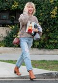 Julianne Hough is all smiles as she leaves a business meeting in West Hollywood, Los Angeles