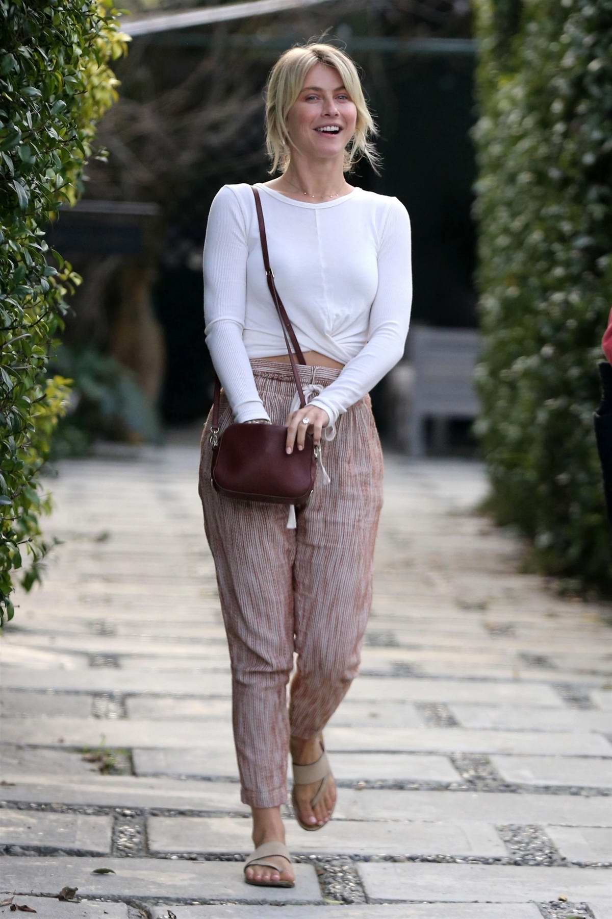 Julianne Hough spotted in a white long sleeve shirt and pink patterned pants while out with a friend in Hollywood, California