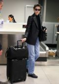 Kaia Gerber and Wellington Grant leaves their hotel and heads to the airport in Milan, Italy