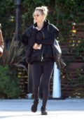Kaley Cuoco wore a black jacket with matching leggings and trainers while she grabs lunch with a friend at the Sun Cafe in Los Angeles