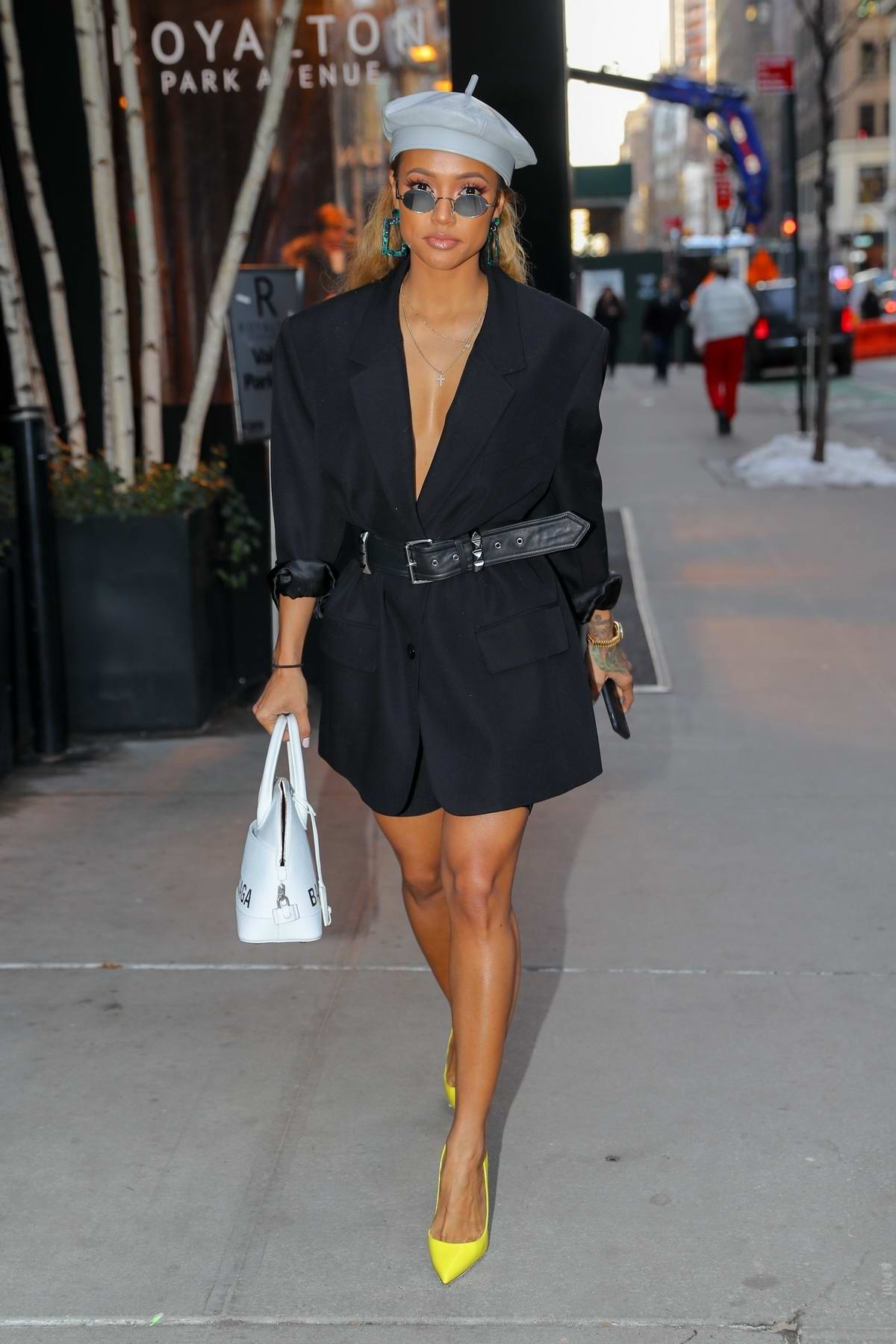 Karrueche Tran keeps it stylish with a short black dress, bright yellow pumps and a beret while out in New York City