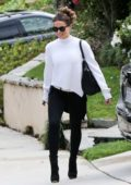 Kate Beckinsale boards a limo as she heads to a Super Bowl viewing party in Los Angeles