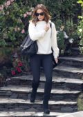Kate Beckinsale seen wearing a white sweater, black leggings and knee high boots as she leaves her home in Brentwood, Los Angeles