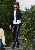 Kate Beckinsale slips into black PVC pants after a workout in Los Angeles