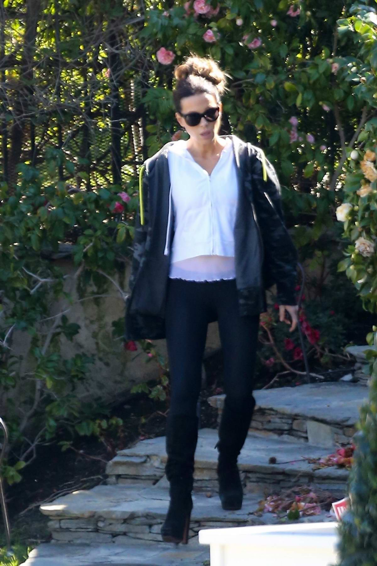 Kate Beckinsale wore a white cropped hoodie, black camo jacket and black leggings as she heads out Los Angeles
