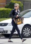 Kate Mara hides her baby bump behind a Céline Tote while out running errands in Beverly Hills, Los Angeles