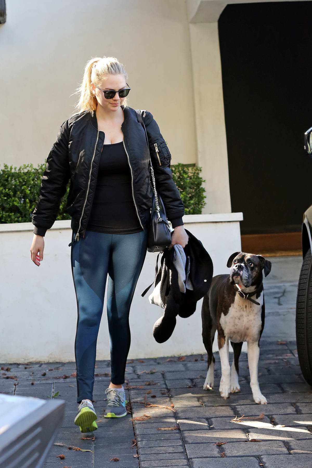 Kate Upton rocks a black jacket with a black top, blue leggings and Nike trainers as she leaves after her workout session in Los Angeles