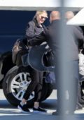 Kate Upton seen boarding a private jet with her daughter at the Van Nuys airport in Van Nuys, California