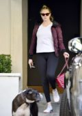 Kate Upton wears a burgundy jacket, white top and black leggings as she leaves another workout session in Los Angeles