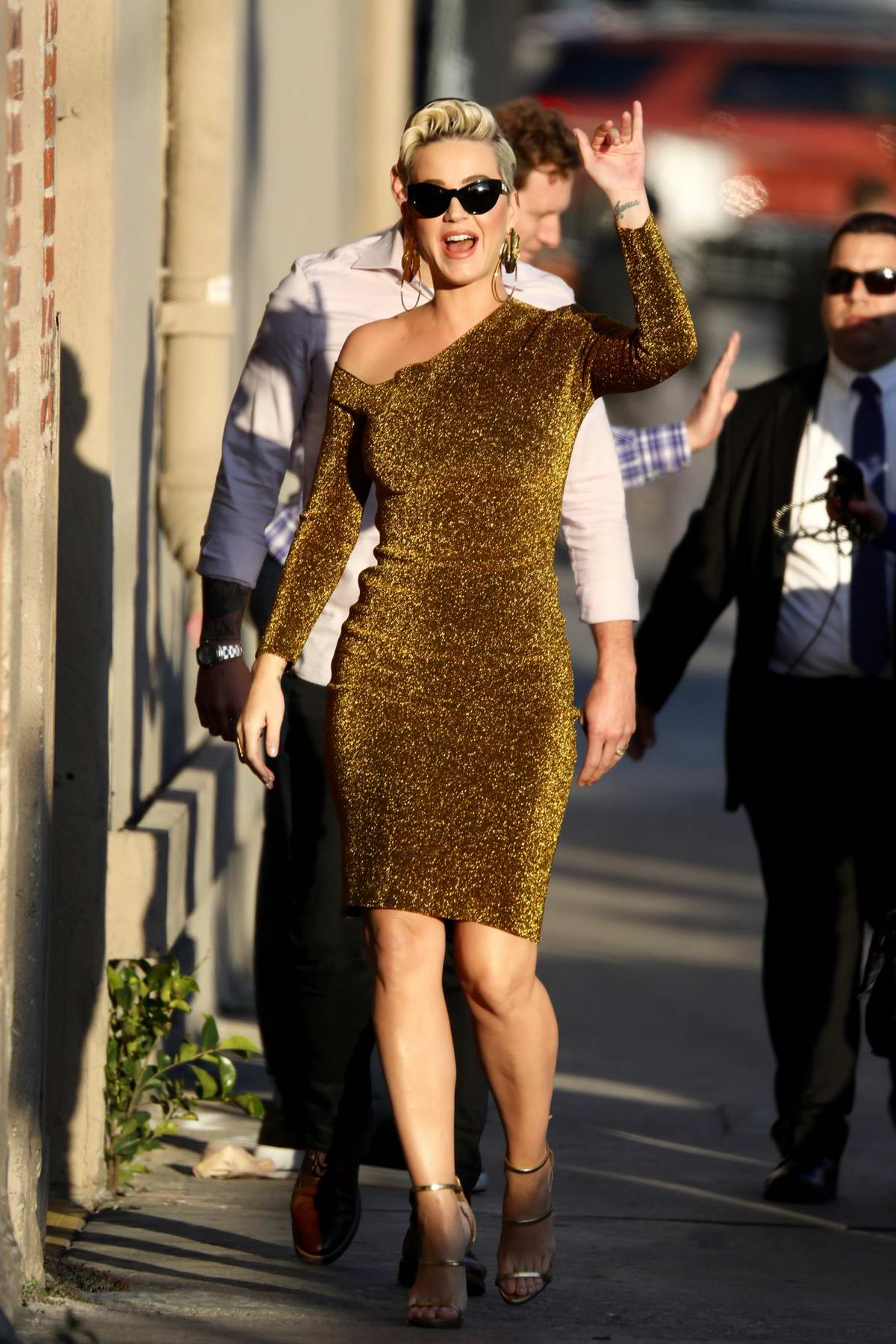 Katy Perry sparkles in a gold dress as she arrives for her appearance on Jimmy Kimmel Live! in Los Angeles