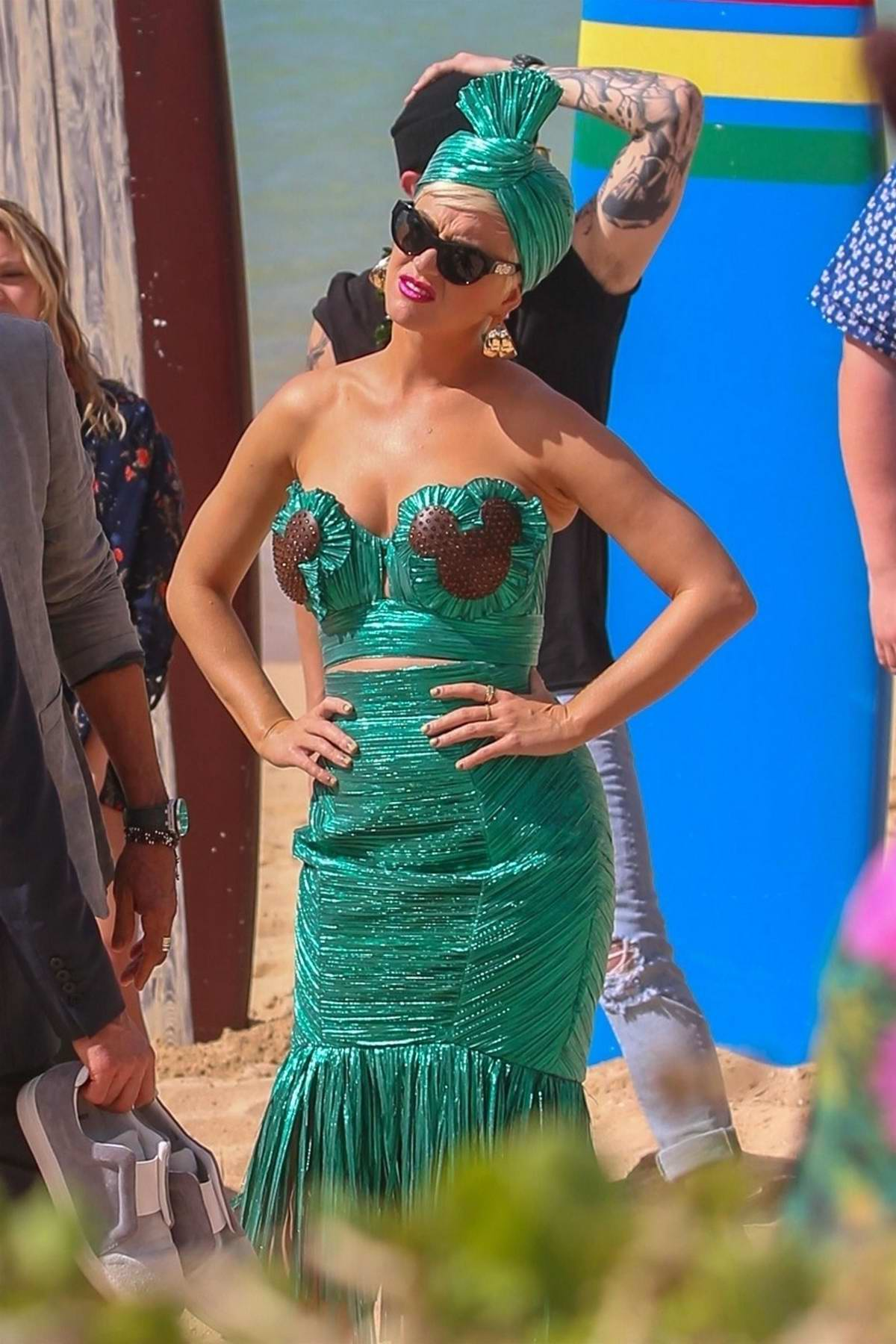 Katy Perry spotted in a green strapless dress while filming on the beach for the upcoming season of American Idol in Oahu, Hawaii