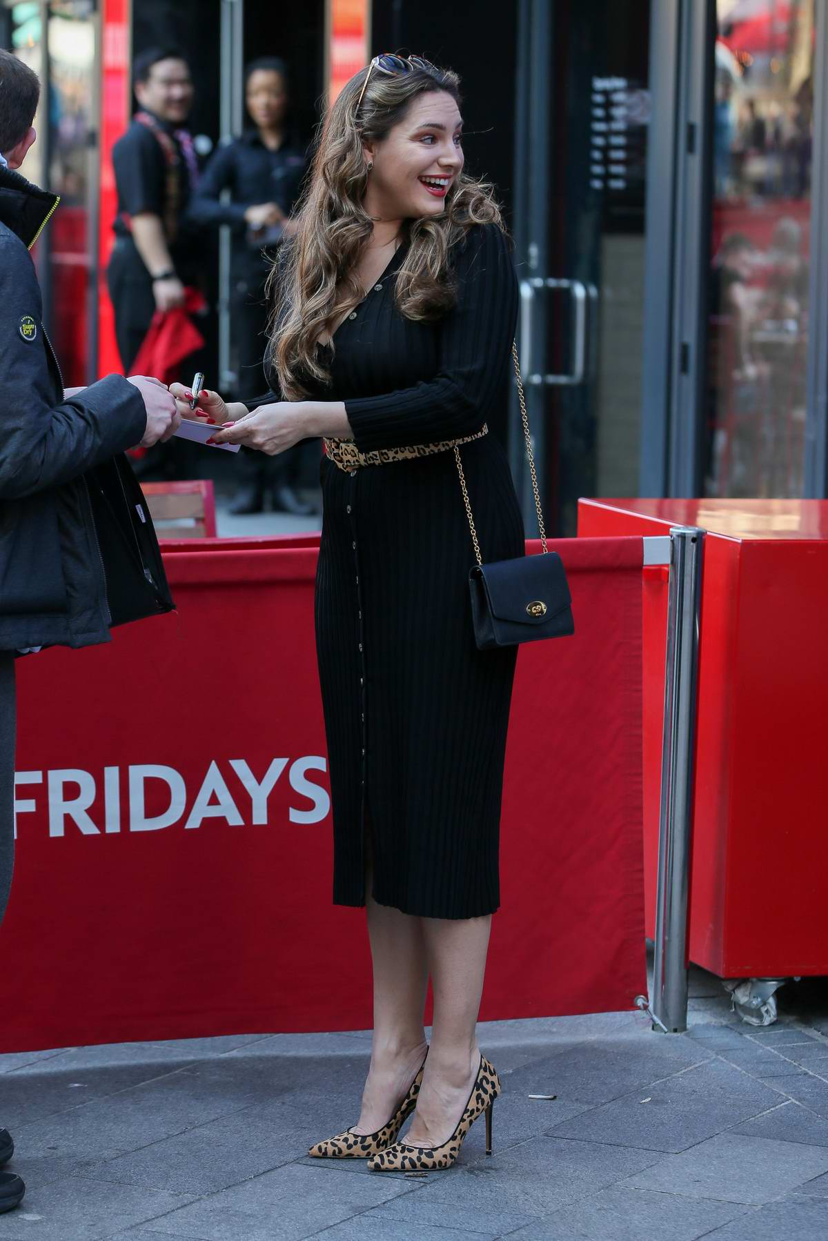 Kelly Brook Dons A Plunging Black Dress With Leopard Print