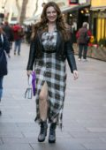 Kelly Brook looks pretty in plaid on Valentine's Day while heading to Global Radio studios in London, UK
