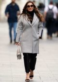 Kelly Brook steps out in a grey blazer and black leather pants while heading to the Global Radio studios in London, UK