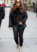 Kelly Brook wears a black fur and leather jacket with green shorts as she heads to the Heart Radio studios in London, UK