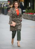 Kelly Brook wears a leopard print coat with matching heels as she arrives at Global Radio studios in London, UK