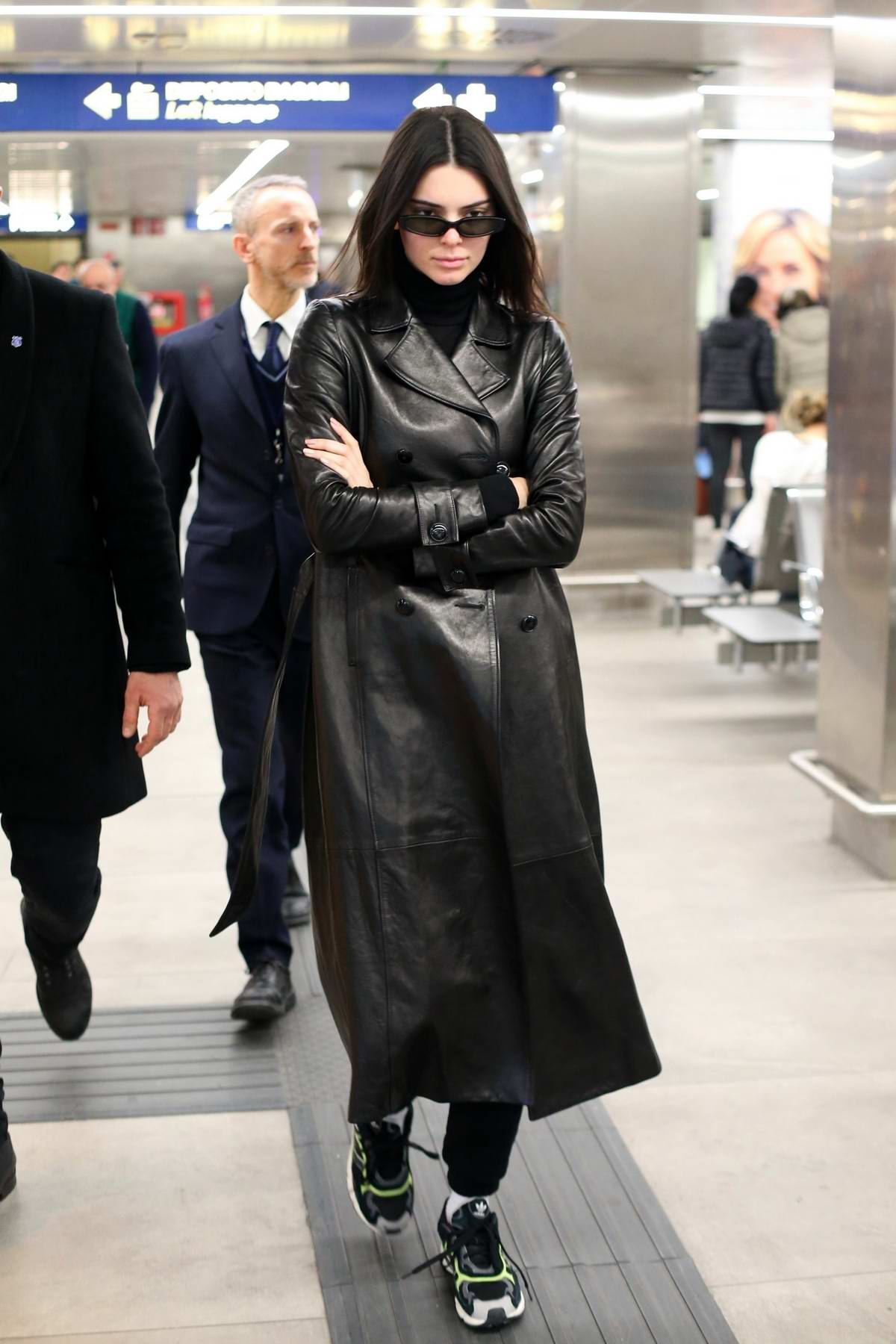 Kendall Jenner dressed in a long leather coat arrives for Milan Fashion Week in Milan, Italy