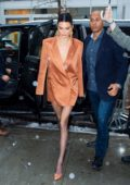 Kendall Jenner looks chic in a coral orange blazer dress with matching pumps as she heads out during the fashion week in New York City