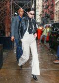 Kendall Jenner looks dapper in a black leather jacket as she heads to Root Studios in New York City
