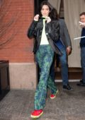 Kendall Jenner looks trendy in a black leather jacket, neon green top, patterned green pants with red and green sneaker while out in New York City