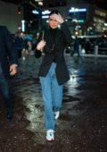 Kendall Jenner rocks a black blazer, jeans and sneakers as she heads to take a train from Penn Station in New York City