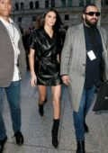 Kendall Jenner rocks a short black leather dress as she heads to the Long Champs Fashion Show during New York Fashion Week in New York City