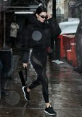 Kendall Jenner steps out under the rain in all black athleisure ensemble in New York City