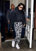 Kendall Jenner wears a black puffer jacket and zebra print pants as she leaves the Mercer Hotel in New York City
