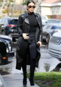 Kim Kardashian dons all black as she joins Kourtney Kardashian and Scott Disick for lunch in Los Angeles