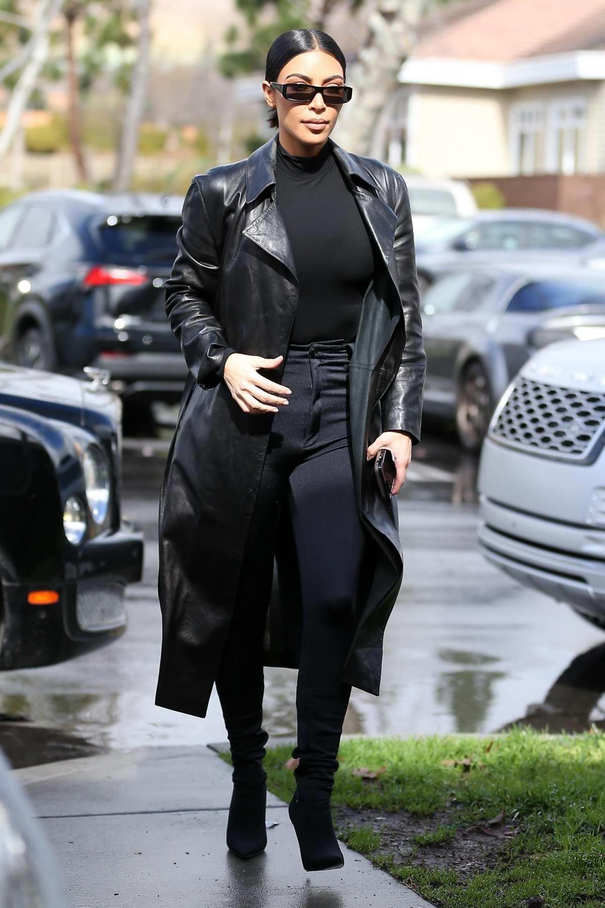 Kim Kardashian dons all black as she joins Kourtney Kardashian and Scott Disick for lunch in Los Angeles