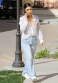 Kourtney Kardashian rocks a white Fendi Shirt and ripped jeans while out in Calabasas, California
