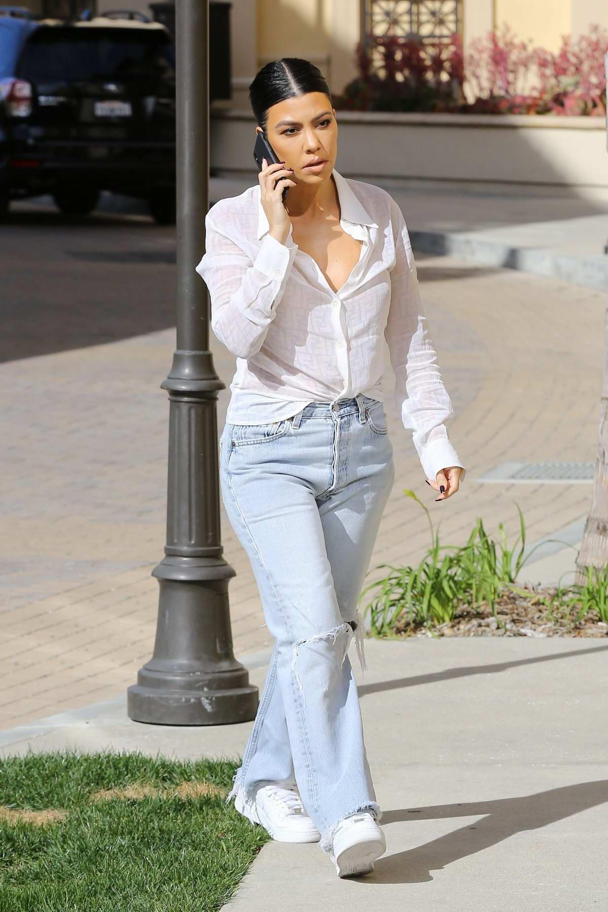 Kourtney Kardashian rocks a white Fendi Shirt and ripped jeans while out in Calabasas, California