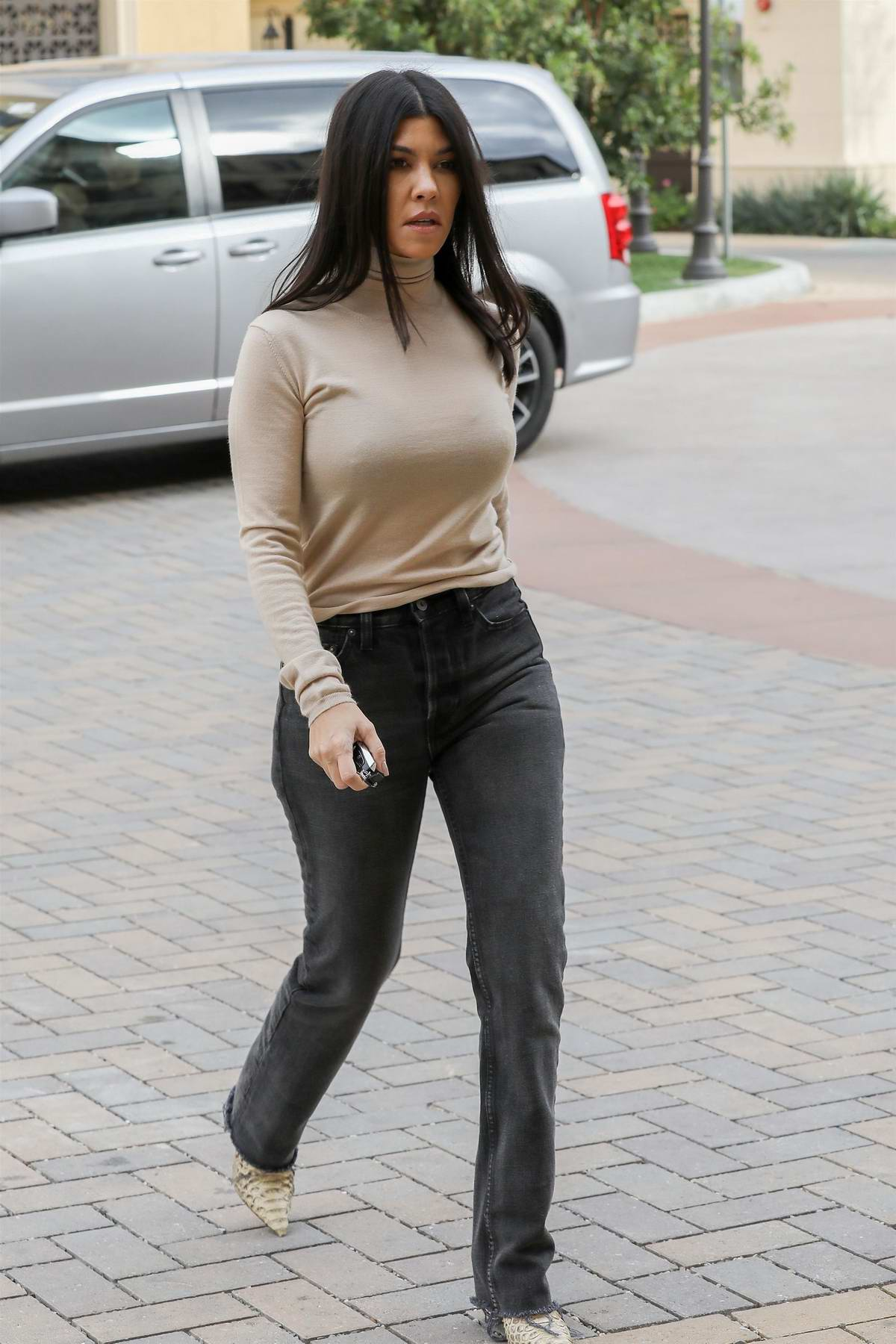 Kourtney Kardashian wore a beige top while stopping by at her grandmother's place in Calabasas, California