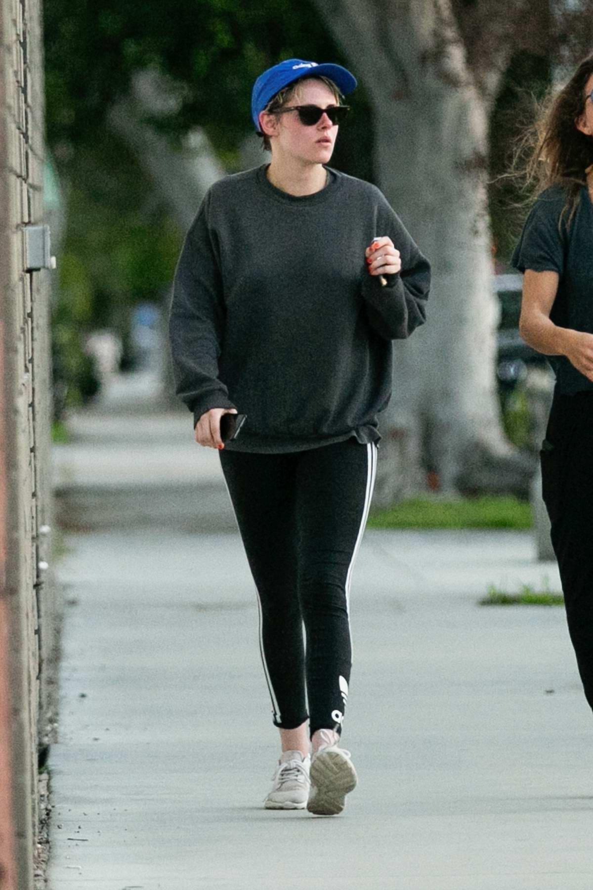 Kristen Stewart keeps it casual in a grey sweatshirt and black leggings while visiting a spa in Los Angeles