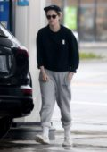 Kristen Stewart steps out in sweats as she stops by a gas station to fill up her Porsche Cayenne in Los Feliz, California