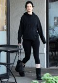 Krysten Ritter covers her baby bump with a black hoodie as she leaves a pilates class in Hollywood, California