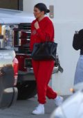 Kylie Jenner seen wearing red sweats as she arrives for a quick shoot at Milk Studio in Los Angeles