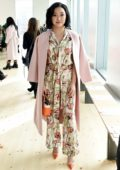 Lana Condor attends Tory Burch Fall Winter Fashion Show at Pier 17 in New York City