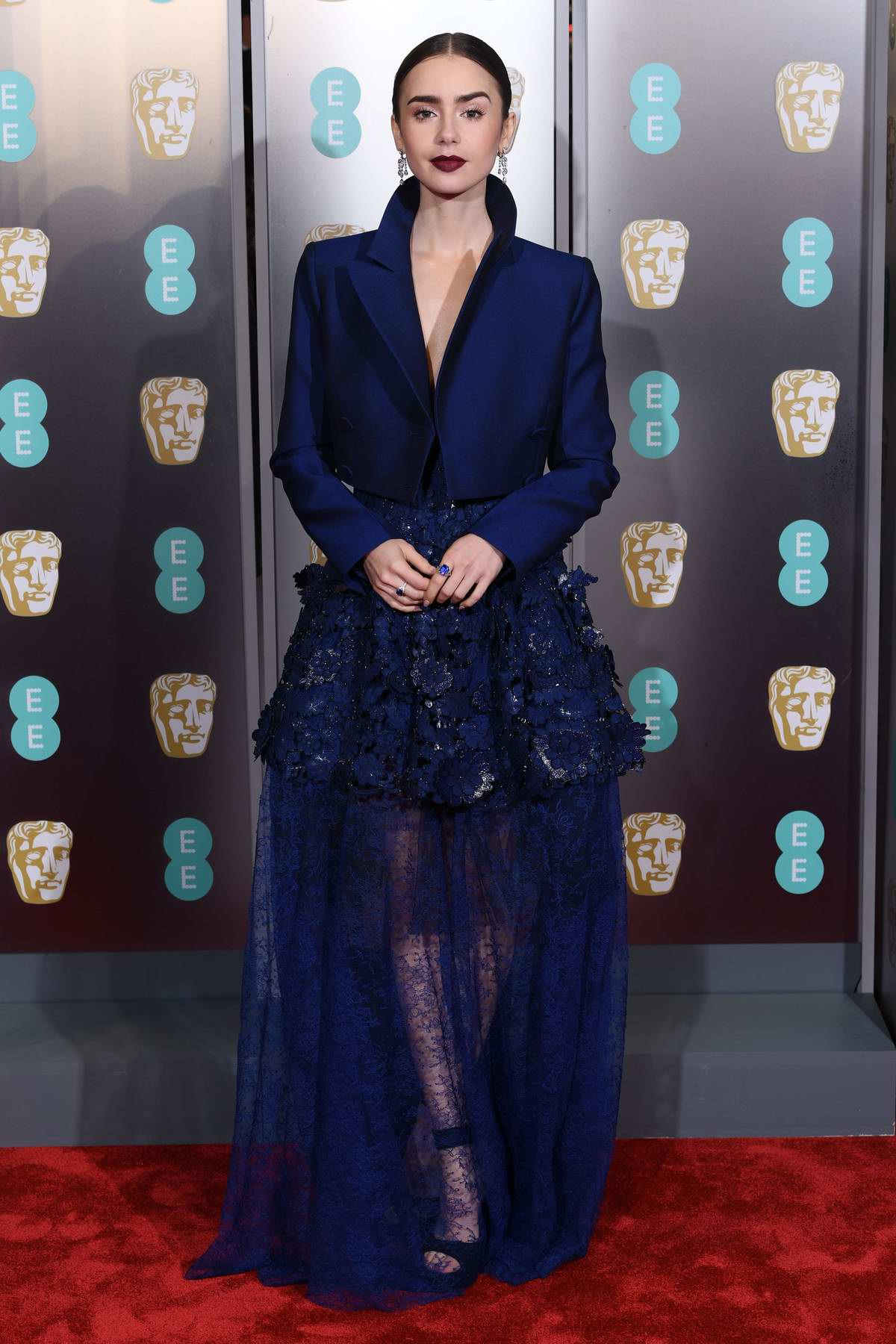 Lily Collins attends the 72nd EE British Academy Film Awards (BAFTA 2019) at Royal Albert Hall in London, UK