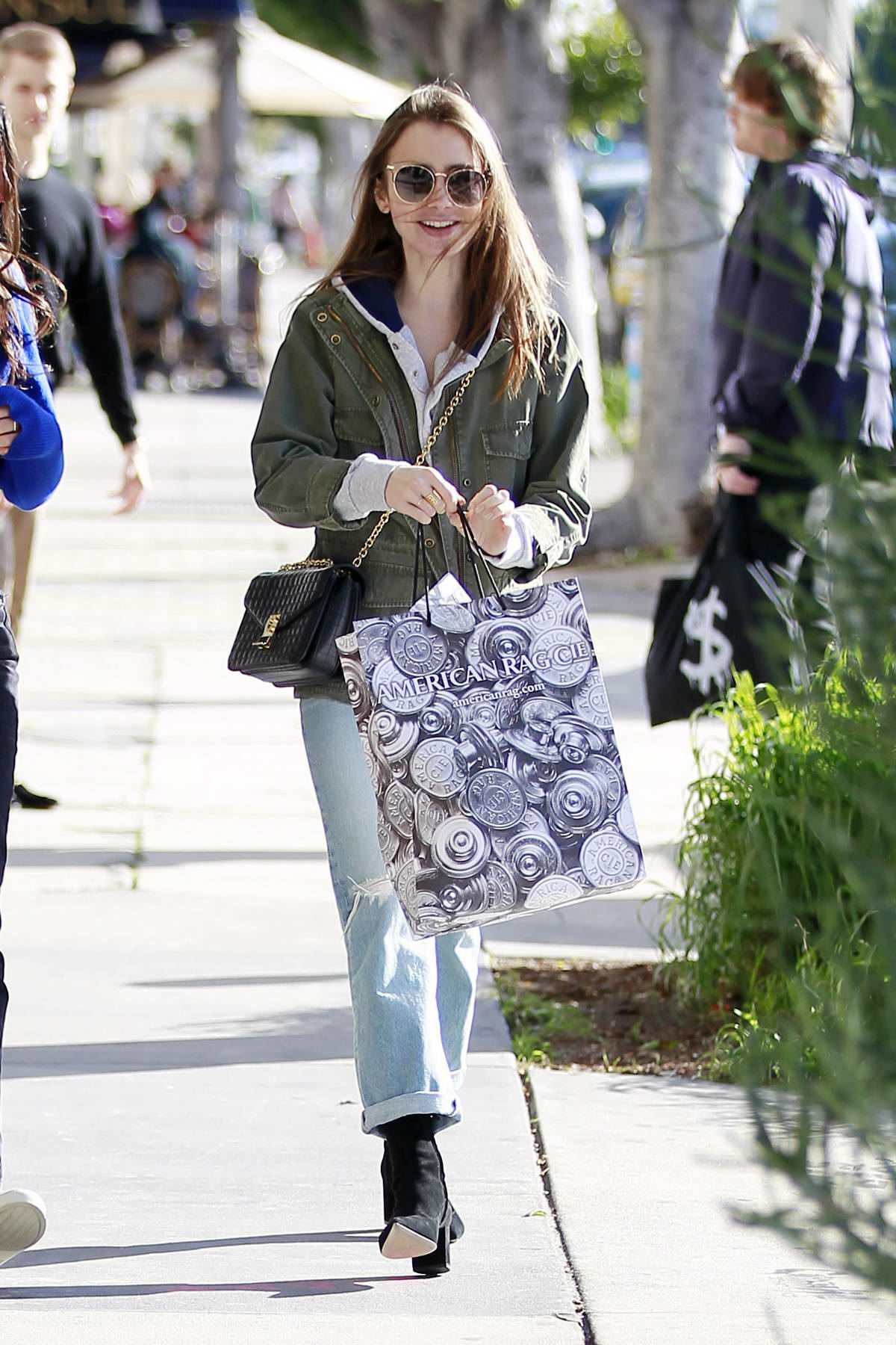 Lily Collins enjoys some retail therapy with a friend at American Rag in West Hollywood, Los Angeles