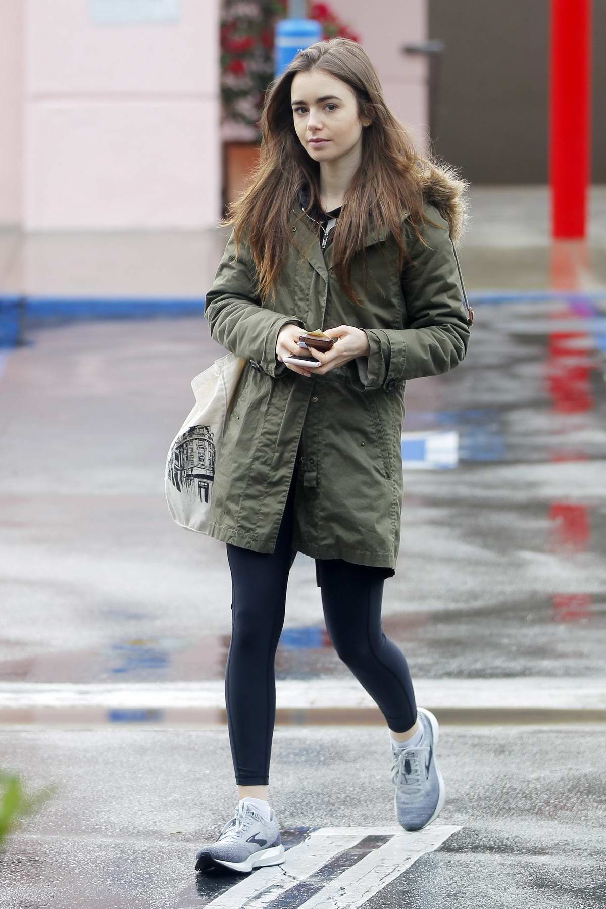 Lily Collins steps out for some grocery shopping after finishing her workout in West Hollywood, Los Angeles