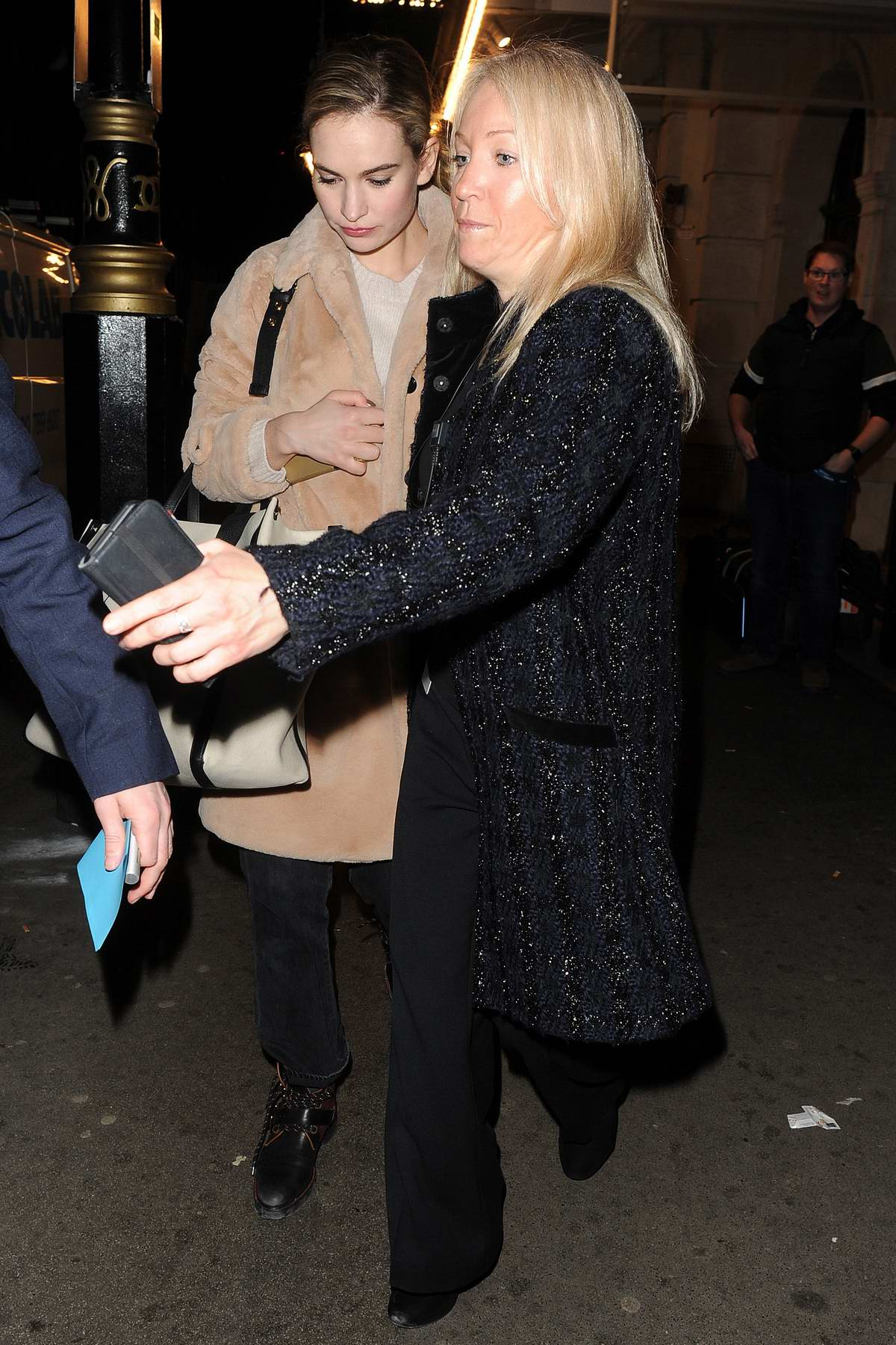 Lily James carries a Valentino bag as she leaves the Noel Coward Theatre Carrying in London, UK
