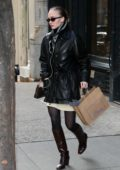 Lily-Rose Depp steps out in a black leather jacket, brown knee high boots and Louis Vuitton purse during a shopping trip in New York City