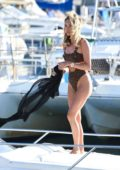 Megan McKenna spotted in an animal print swimsuit enjoys the sun on a boat in Tenerife, Spain