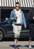 Mila Kunis keeps it simple with a denim jacket and sweat pants while out with her assistant grabbing coffee at Alfred's in Beverly Hills, Los Angeles
