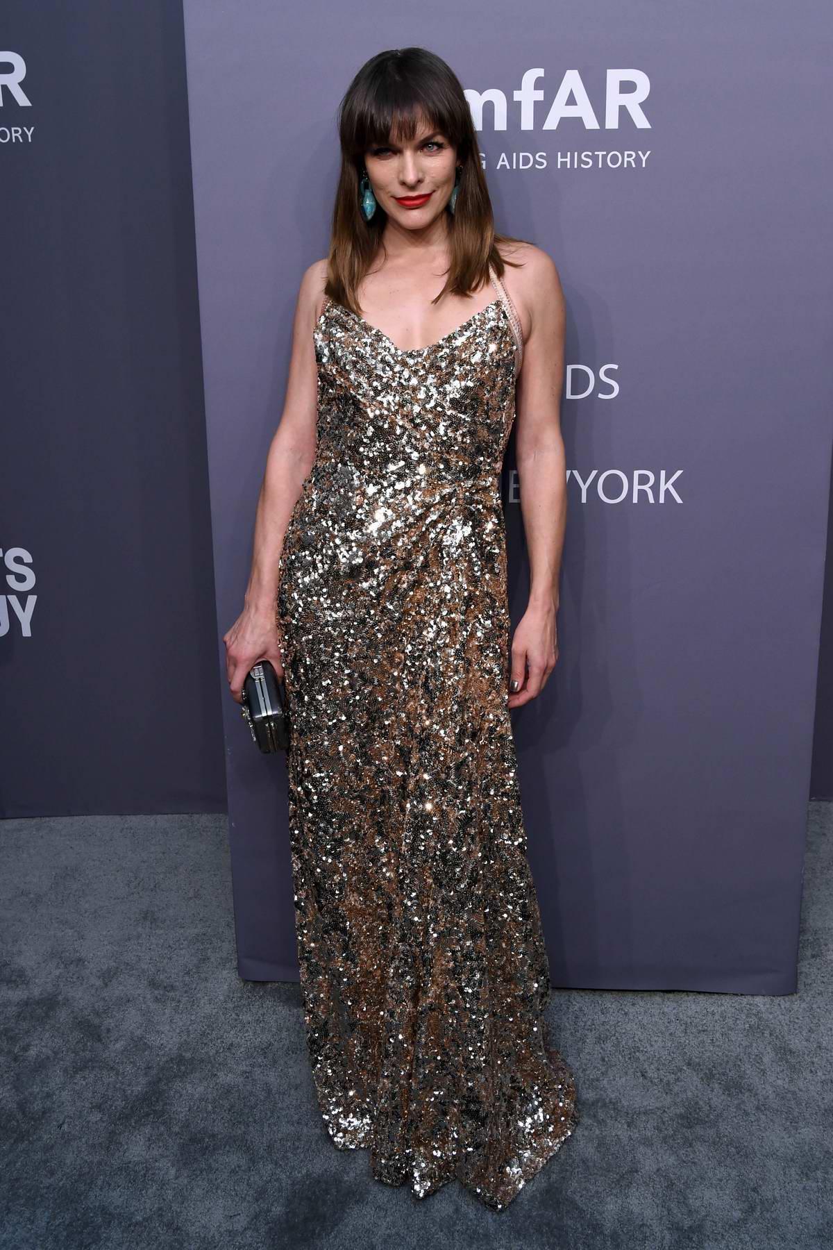 Milla Jovovich attends amfAR New York Gala 2019 at Cipriani Wall Street in New York City