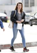 Milla Jovovich steps out in jeans and leather jacket during a shopping trip with her Mom in West Hollywood, Los Angeles